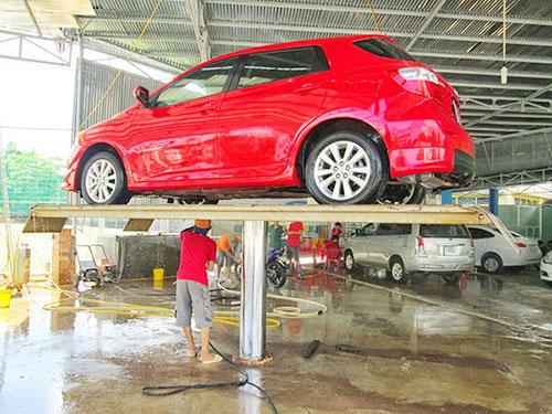 Cầu nâng ô tô 1 trụ cho cửa hàng rửa xe